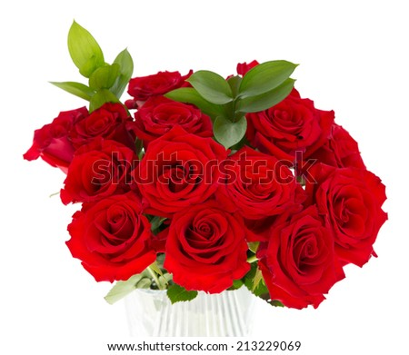 A bouquet of red roses in a glass vase isolated on a white background.