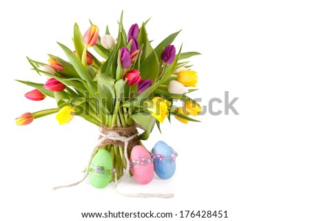 a Bouquet of tulips with three colorful easter eggs, isolated on white