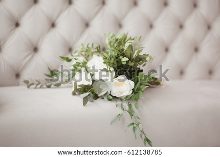 A bouquet of white flowers with green branches