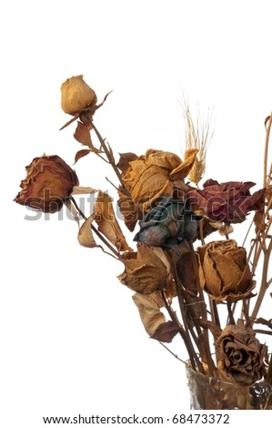 A bouquet of withered roses and flowers on white background