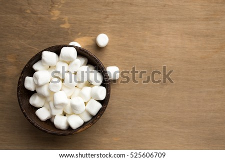 A bowl full of mini marshmellows treats from above.