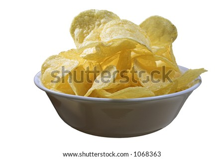 A bowl full of potato chips - stock photo