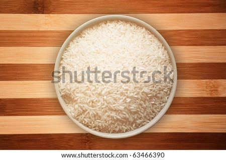 A bowl full of white rice - stock photo