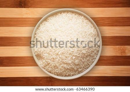 A bowl full of white rice - stock photo