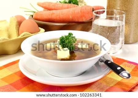 a bowl of Beef soup with Royal and parsley