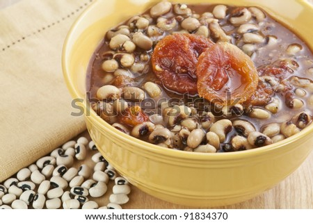 a bowl of black eye peas or hoppin' john - stock photo