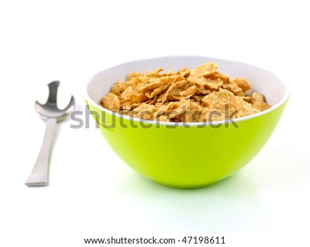 A bowl of breakfast cereal isolated against a white background - stock photo