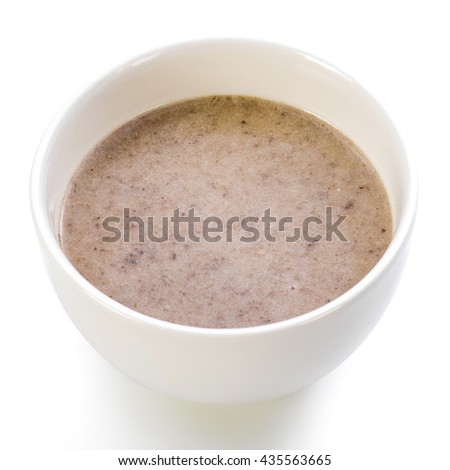 A bowl of buckwheat soup on a white background