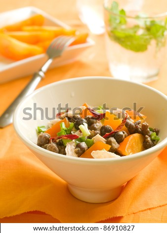 A bowl of chicken salad with black bean and green spring onions. Selective focus