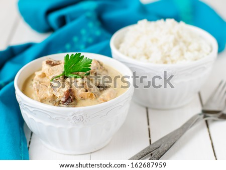 A Bowl of Chicken, Wild Mushroom and Sour Cream Stew and a Bowl of Rice