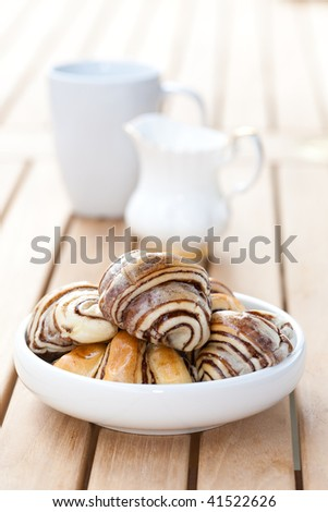 A bowl of chocolate croissant in an outdoor setting. - stock photo