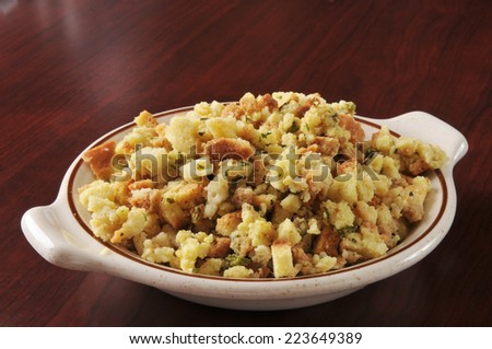 A bowl of cornbread stuffing in turkey broth - stock photo