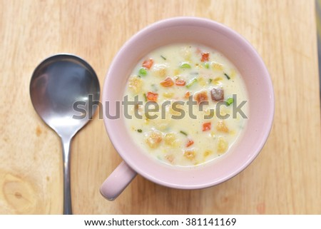 A bowl of creamy vegetable soup with Spoon,top view - stock photo