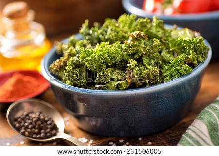 A bowl of crispy delicious baked kale chips. - stock photo