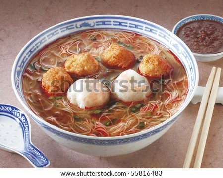 A bowl of curry noodles. - stock photo