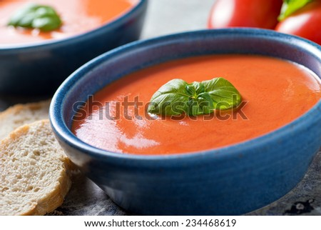 A bowl of delicious home made tomato basil soup. - stock photo