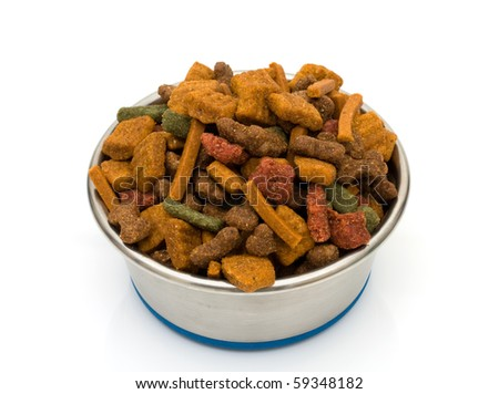 A bowl of dog food isolated on a white background, treats for the dog - stock photo