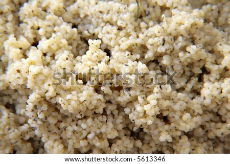 A bowl of flavored spiced cous cous as dinner carbohydrate - stock photo