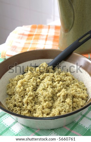 A bowl of flavored spiced couscous as dinner carbohydrate - stock photo