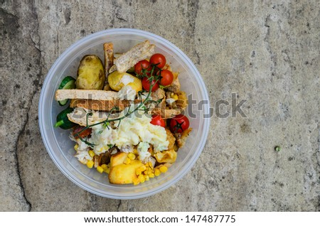 A bowl of food recycling waste on a stone background - stock photo