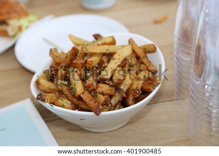 a bowl of french fries with parmesan and truffle - stock photo