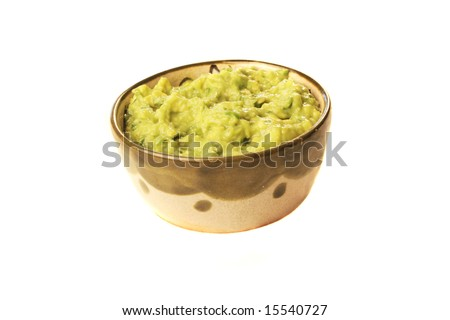 A bowl of fresh guacamole isolated on white - stock photo