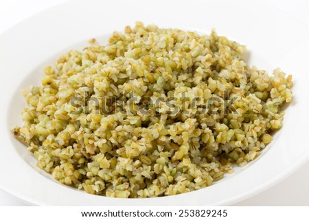 "A bowl of freshly boiled cracked freekeh scorched green wheat grains, one of the ""paleo superfoods"". It can be eaten as it is or used in a wide range of dishes. - stock photo"