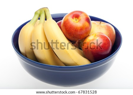 "A bowl of fruit with nectarines, bananas and apples. Photographed in front of a white backdrop, but not ""cut out"" with software. - stock photo"