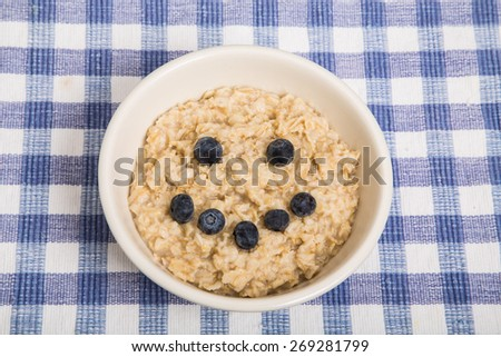 A bowl of hot, fresh cooked oatmeal - stock photo