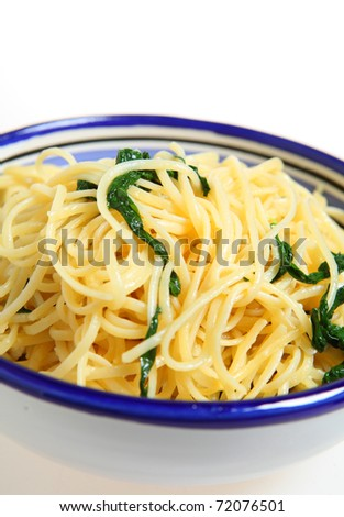A bowl of linguine pasta with olive oil, rocket and parmesan.