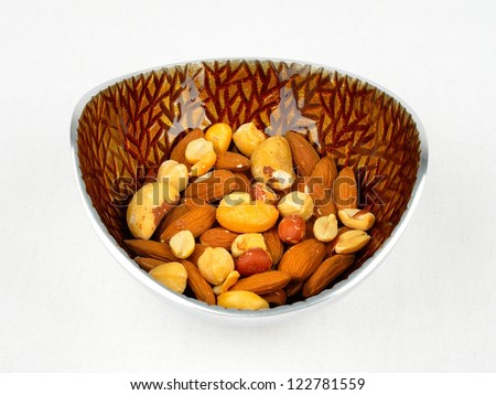 A bowl of mixed assortment of nuts - stock photo