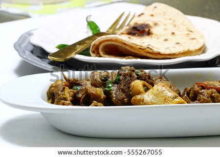 A bowl of mutton curry or Rogan josh, selective focus.