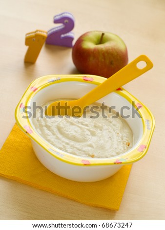 A bowl of oatmeal porridge for baby. Shot for a story on homemade, organic, healthy baby foods. - stock photo