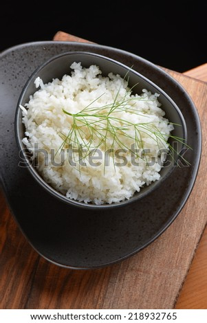 A bowl of perfectly cooked, plain Basmati rice, in an Asian style bow - stock photo