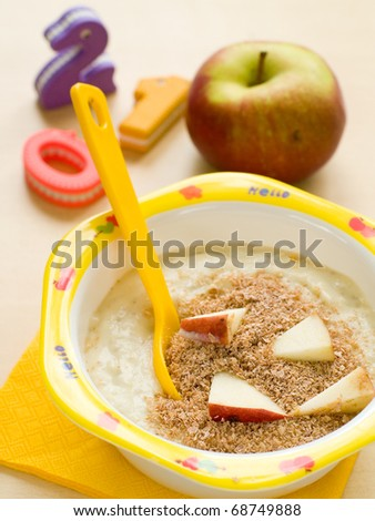 A bowl of porridge for children. Shot for a story on homemade, organic, healthy baby foods. - stock photo