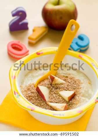 A bowl of porridge for kids. Shot for a story on homemade, organic, healthy baby foods. - stock photo