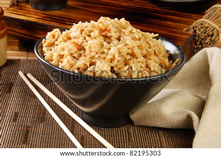 A bowl of rice seasoned in beef broth and spices - stock photo