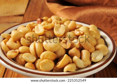a bowl of roasted and salted spanish peanuts closeup