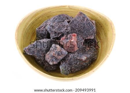 A bowl of rock salt - Black Indian Salt crystals (Himalayan Pink Salt)  - stock photo