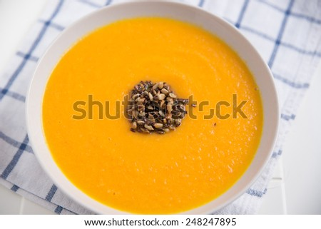A bowl of spicy carrot soup - stock photo