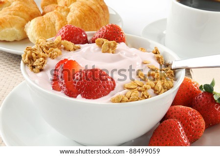 A bowl of strawberry yogurt with honey oat granola - stock photo
