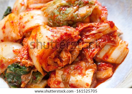 A bowl of stuffed pasta and red sauce. - stock photo
