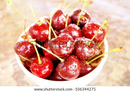 A bowl of sweet red cherries. - stock photo