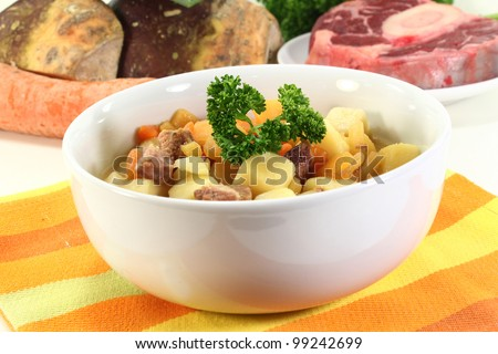 a bowl of turnip stew with parsley and cook meat