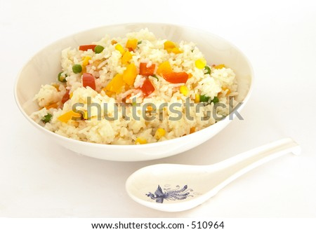 A bowl of vegetable fried rice, with a spoon