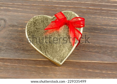 a box for a gift in the shape of a heart. photo icon for valentine's day, wedding, engagement. - stock photo