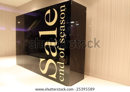 a box for sale AD in a store window - stock photo