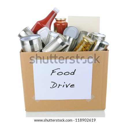 A box full of canned and packaged foodstuff for a charity food donation drive. Isolated on white with reflection. Cans have no labels and the box has a hand made sign. - stock photo