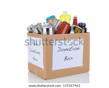 A box full of canned and packaged foodstuff for a charity food donation drive. Isolated on white with reflection. Cans have no labels. Box is at an angle showing two sides both with hand made signs. - stock photo