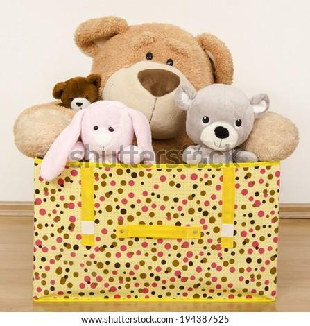 A box full of toys, three bears and a funny rabbit - stock photo